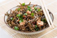 Warm sea cabbage salad with fried tofu, closeup Royalty Free Stock ...