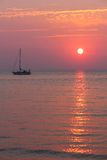 Warm Setting Sun & Sailboat Royalty Free Stock Photography