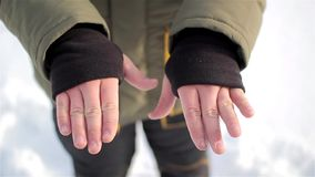 Warm sleeve cuffs with thumb hole. man`s hands. stock video footage