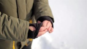 Warm sleeve cuffs with thumb hole. man`s hands. stock footage