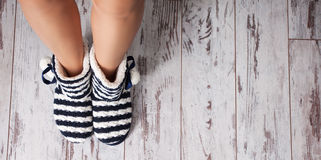 Warm slippers on the background floor Royalty Free Stock Image