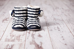 Warm slippers on the background floor Stock Photo
