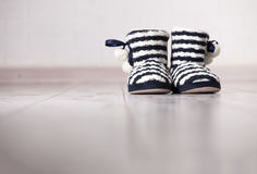 Warm slippers on the background floor Royalty Free Stock Photos