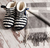 Warm slippers on the background floor Royalty Free Stock Photo