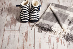 Warm slippers on the background floor Stock Photos