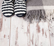Warm slippers on the background floor Royalty Free Stock Images