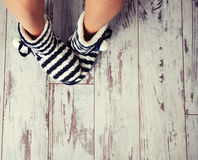 Warm slippers on the floor Stock Photography
