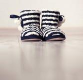 Warm slippers on the floor Stock Photo