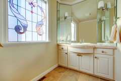 Warm small bathroom with great idea for window treatment Royalty Free Stock Photography