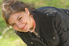 Warm Smile 4. Young woman sitting beneath a tree smiling Royalty Free Stock Images