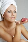 Warm spa. Lovely woman with red candle in spa salon Royalty Free Stock Images