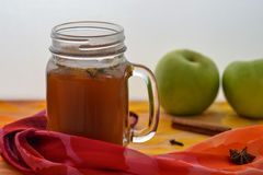 Warm spiced apple cider on table Stock Photo