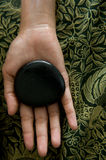 Warm stone therapy royalty free stock photography