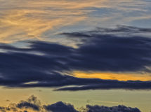The Warm Streak. Storm clouds with the glow of the sunset in them in Cottonwood Heights Utah USA Stock Images