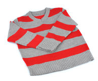 Warm striped sweater. On a white background.Children's clothes Stock Image