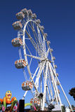 Warm summer day at the carnival. With ferris wheel Royalty Free Stock Image