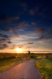 Warm summer sunrise and windmill Stock Images