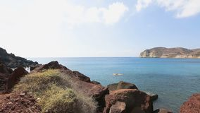 Warm summer wind gently pushing little uncertain waves of Aegean sea to shore. Stock footage stock footage