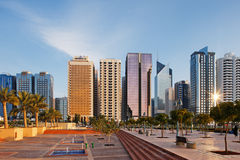 A warm sun illuminates the Abu Dhabi Skyline Stock Images