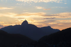 Warm sun light behind Mountain Corcovado during sunset  in Rio de Janeiro Stock Photo