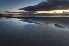 Warm sundown over sand beach Royalty Free Stock Photo