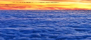 Warm sunlight above clouds in the evening. Panoramic background in the evening above sunset cloudscape. Warm sunlight above clouds in summer stock photo