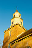 Warm sunlight on Bruton parish church tower Stock Images