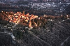 Sacred Mount of Varese, landscape at sunset. Warm sunny light on the ancient village of Sacred Mount of Varese in a winter afternoon Royalty Free Stock Images
