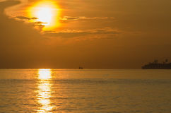 Warm sunrise in indonesia. Warm sunrise at the sea in indonesia royalty free stock photo
