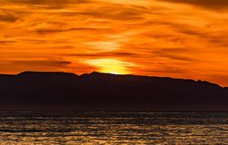 Warm sunrise over the horizon stock image