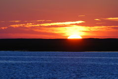 Warm Sunset. A warm sunset setting on the ocean Royalty Free Stock Photo