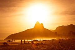 Warm Sunset on the Beach with Mountains in Horizon Royalty Free Stock Photos