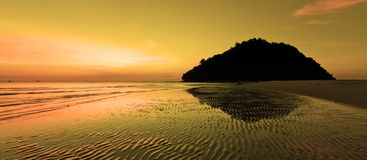 Warm sunset at a beach in Sabah, Borneo Royalty Free Stock Photography