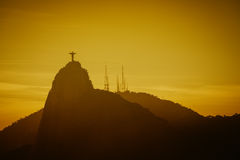 Warm Sunset with Christ Redeemer silhouette in Rio de Janeiro Royalty Free Stock Photography