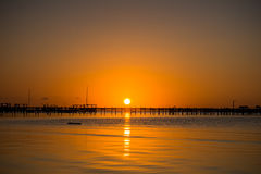 Warm Sunset with Dock Silhouette Stock Images