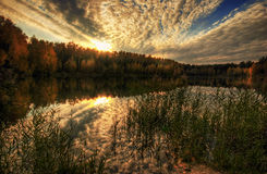 Warm sunset of gold lake royalty free stock photos