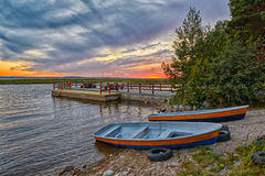 Warm Sunset Lake Boats and Pier Stock Images