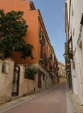 Warm sunset light on Carrer Tarrul, Tossa de Mar Stock Photos