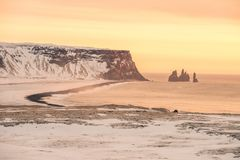 A warm sunset over a snowy coastline in Iceland. This picture shows a warm sunset over a snowy coastline in Iceland stock photography