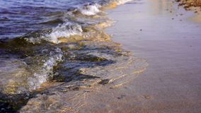 Warm sunset powerful tropic sea waves on the beach. Rocky bottom and clear water stock footage