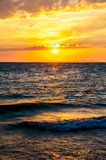 Warm sunset and waves on the sea in southern Croatia Royalty Free Stock Images