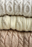 Warm sweaters. Beautiful stack of warm sweaters closeup Royalty Free Stock Photography