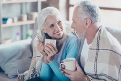 Warm sweet peaceful conversation between two  full of happiness. Old people who are resting, relaxing, sitting at home and drinking hot coffee at the vacation Royalty Free Stock Photo
