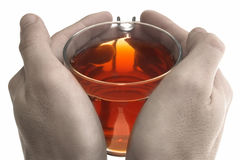 Warm tea. Holding a cup of wwarm tea in hands Royalty Free Stock Image