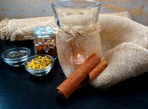 Warm Tea ambiance with candle and burlap at wooden background stock photography