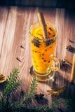 Warm tea orange cloves ginger lemon honey Royalty Free Stock Images