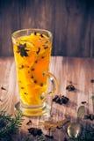 Warm tea orange cloves ginger lemon honey Stock Photo