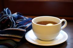Warm tea with scarf Royalty Free Stock Photography