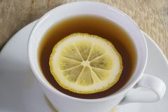 Warm tea with slice of fresh lemon Royalty Free Stock Photography