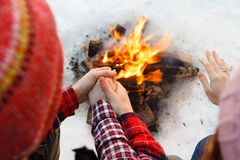 They warm their hands by the fire. Winter Royalty Free Stock Photography